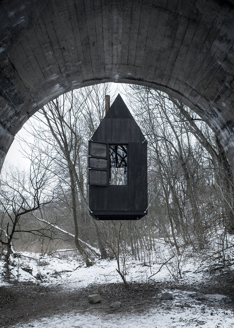 Levitating black house under the bridge in the Czech Republic